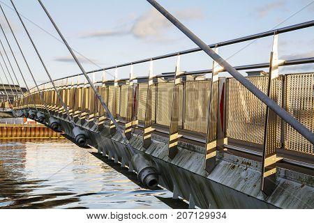 The Millennium footbridge over the River Tawe at Swansea Marina in the popular Maritime Quarter.