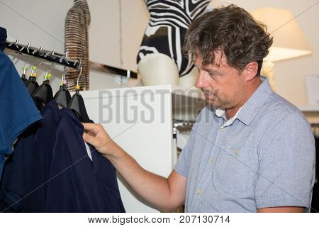 Shopper Man Look Some Shirt To Buy In Clothes Store