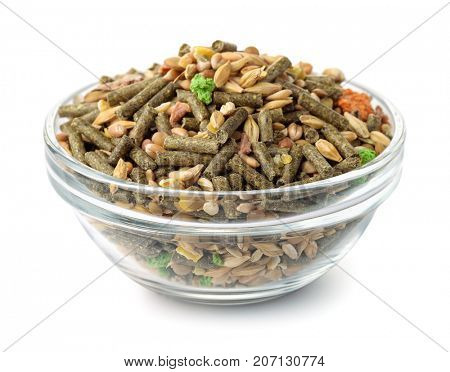 Bowl of compound rodents feed isolated on white
