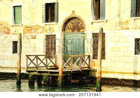 A door on a building along the Grand Canal of Venice.