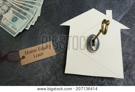Home Equity Loan tag with paper house key and cash