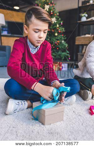 Boy Decorating Christmas Gift