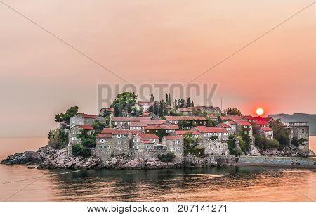 Beautiful view of the island-resort of St. Stephen (Sveti Stefan) on the Budva Riviera, Budva, Montenegro at sunset.