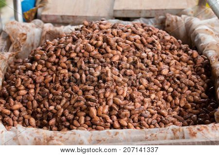 Fermented And Fresh Cocoa-beans Lying In The Wooden Box