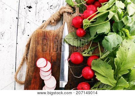 Radish. Sliced Red fresh radish on cutting board. Fresh Vegetable on white table