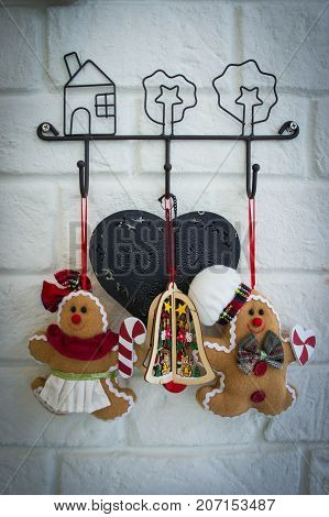 christmas dolls on wall background Christmas carnival Every house will have ornamental dolls.