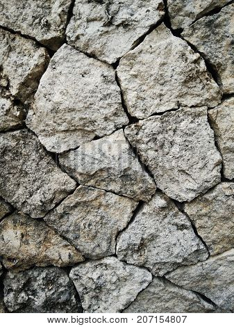 Stone wall rustic texture background. Stone fence texture - building feature. Natural grey stones wall background.