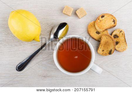 Rusks With Raisin, Cup Of Tea, Lemon, Lumpy Sugar