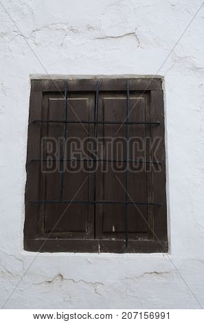 Wooden shutters on white house in the village of Belmonte province of Cuenca Spain.