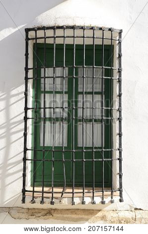 Grille on window on white house in the village of Belmonte province of Cuenca Spain.
