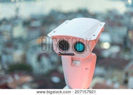 Security camera detects the movement of traffic and terrorist threat. The concept of security and the prevention of terrorism.