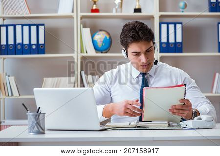 Businessman operator traveling agent working in the office