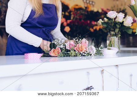 Self-employed Young Woman Owner Of Florist Shop Arranging Bouquet Of Roses