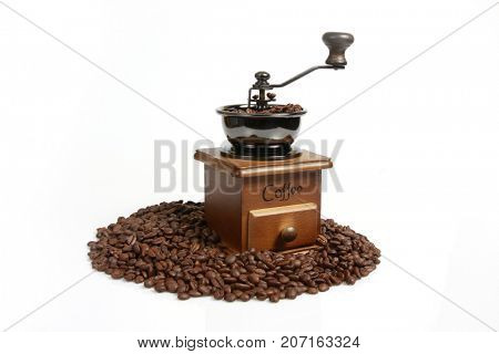 Vintage manual coffee with coffee beans,white backgrounds