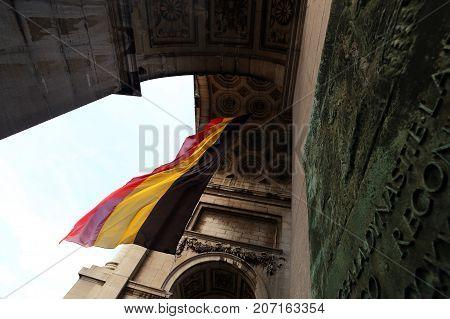 Belgian  flag in famous  triumphal arch in Parc du Cinquantenaire close-up.