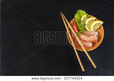 Shrimp On A Wooden Plate With Wooden Chopsticks