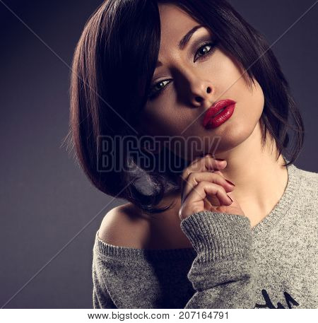 Sexy Cocky Emotion Makeup Woman With Short Bob Hair Style, Red Lipstick Touching Her Face On Dark Sh