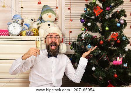 Guy Near Bureau With Toys And Christmas Tree