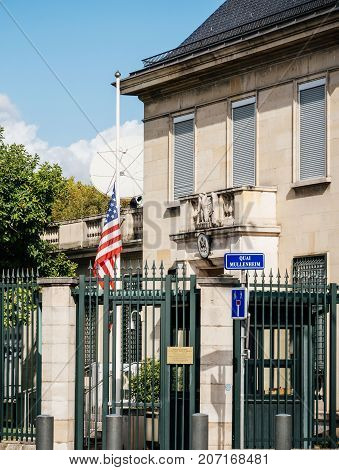 PARIS FRANCE - OCT 3 2017: US United States American Flag flying half-mast in court of the US Embassy after the 2017 Las Vegas Strip shooting in United States with about 60 fatalities and 527 injuries