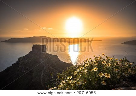 Amazing sunset on the Skaros rock at Imerovigli, Santorini, Crete, Greece.