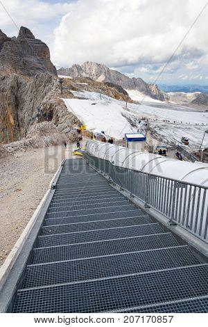 Ramsau Am Dachstein, Austria - August 17: Ski Lift With People Walking To Dachstein Glacier On Augus