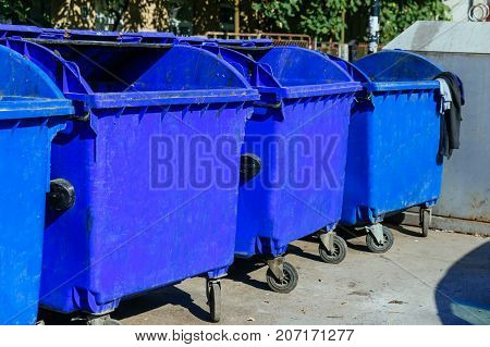 trash cans standing in a row bin Many blue tanks