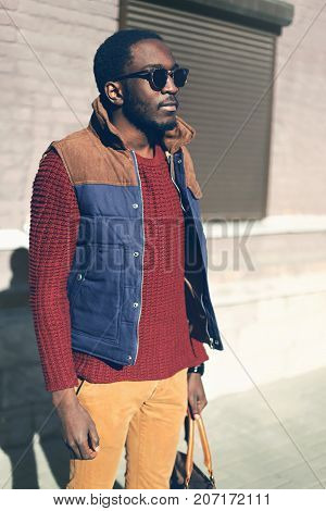 Fashion African Man Wearing A Sunglasses, Knitted Sweater, Vest Jacket Evening In The City