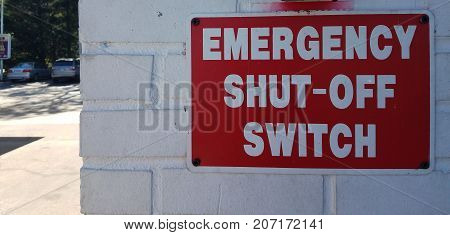 red emergency shut off switch sign at gas station