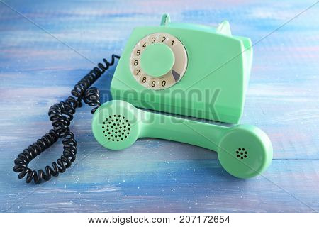 Green Retro Telephone On Blue Wooden Table