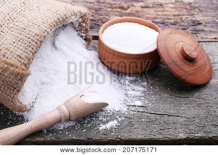 White Sea Salt In Scoop, Sackcloth And Bowl On Grey Wooden Table