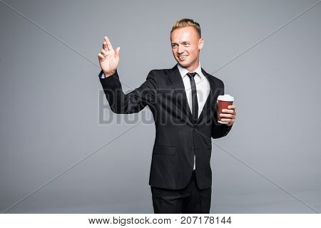 Enjoying Fresh Coffee. Confident Young Charming Man In Formalwear Holding Coffee Cup And Looking Awa