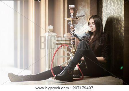 Beautiful Woman Smoke Hookah On Floor