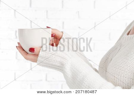 Hands Of A Mature Woman Holding A Cup