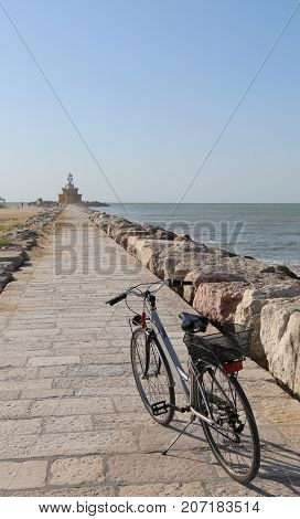 Bike On The Avenue Leading To The Great Lighthouse In Northern I