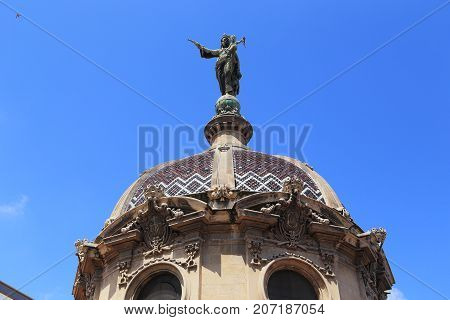 BARCELONA, SPAIN - MAY 11, 2017: This is the dome of the medieval Basilica De La Merce which is adorned with a huge figure of Our Lady with the infant Christ.