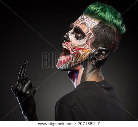 Side view of man with scary zombie face. Mystical face art for Halloween.
