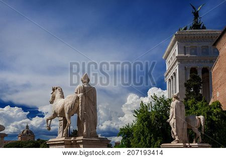 Capitoline Hill in the very center of Rome with ancient roman sculptures (with copy space)