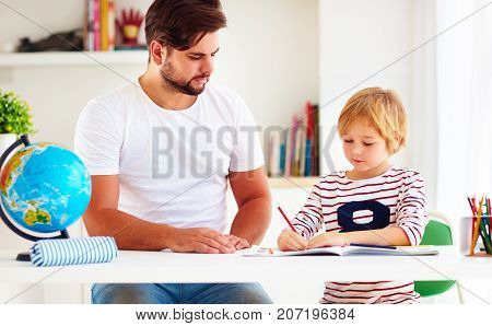 Father And Son At The Desk, Making Homework Together