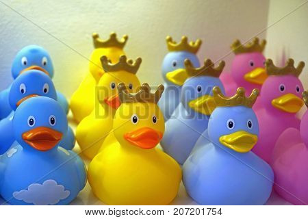 Playful Yellow, Pink, and Blue Rubber Duckies with Crowns