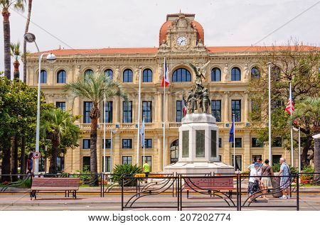 The neoclassical City Hall (Hotel de Ville) of and the War Memorial - Cannes, France, 9 July 2013