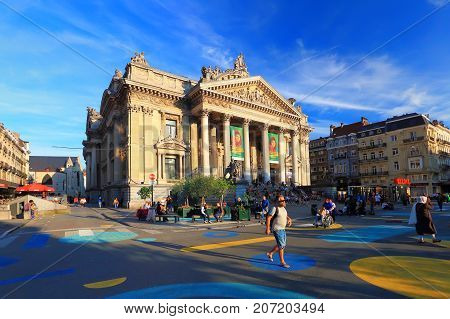 Brussels, Belgium - July 17, 2017: Streets of Brussels in the evening. Tourists relaxing at Brussels street in the evening. Sunny evening in Belgian capital.