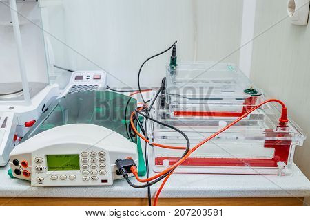 Table with equipment for gel electrophoresis at Biochemical laboratory