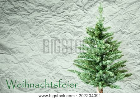 Crumpled Paper Background WIth German Text Weihnachtsfeier Means Christmas Party. Christmas Tree Or Fir Tree In Front Of Textured Background.