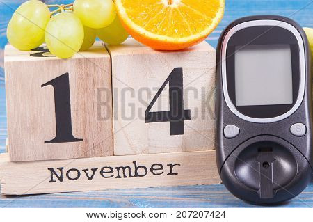 Date Of 14 November, Glucose Meter And Grapes With Orange, World Diabetes Day Concept