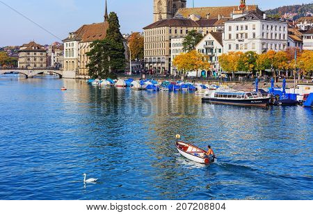 Zurich, Switzerland - 29 September, 2017: the Limmat river in the city of Zurich and buildings along it. Zurich is the largest city in Switzerland and the capital of the Swiss canton of Zurich.