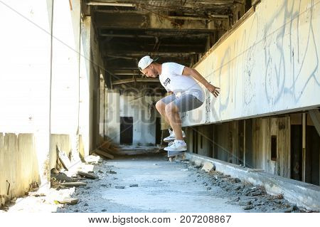 Man Skating In Abandoned Building
