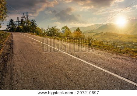 Countryside Road Through Mountains At Sunset