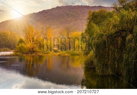 Landscape With Calm River In Autumn At Sunset