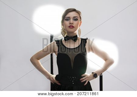 Girl singer with a microphone on a white background. The author and the singer of own songs