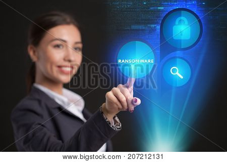 Young Businesswoman Working In Virtual Glasses, Select The Icon Ransomware On The Virtual Display.